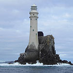 Sailing past the Fastnet Lighthouse on yacht Inishbeg